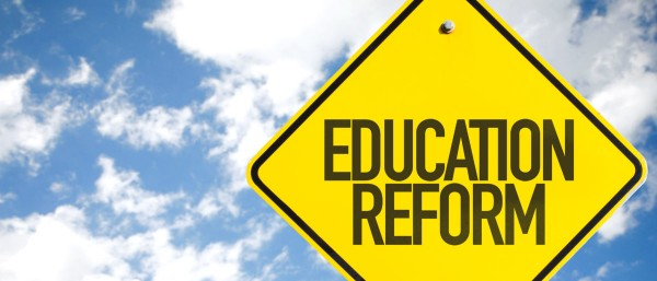 Education-Reform-sign-with-sky-background-e1526420222623